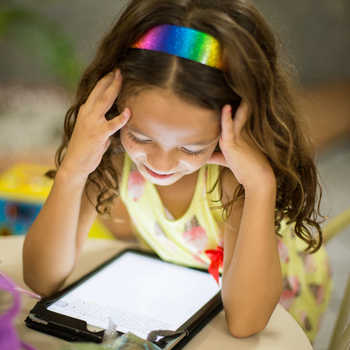 girl reading from tablet